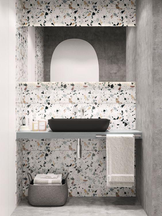 Decoración con terrazo en el baño en la zona del lavabo