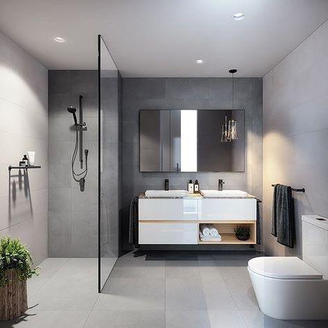 Baño de estilo escandinavo con mampara fija de ducha y muebles ligeros