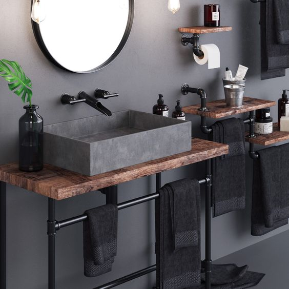 Baño de estilo industrial con partes de metal en negro